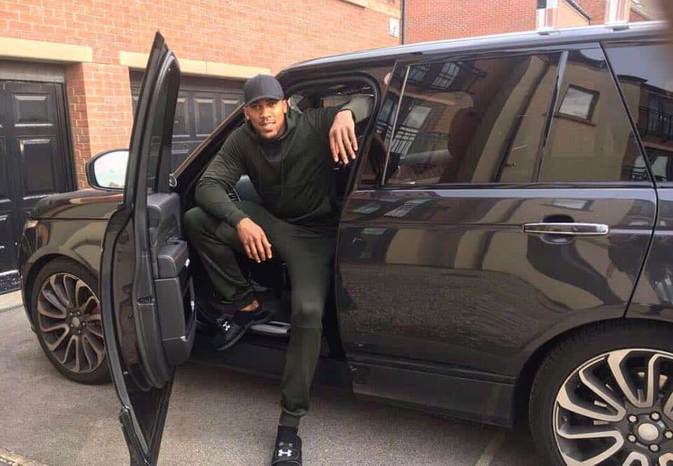 Anthony Joshua with his car