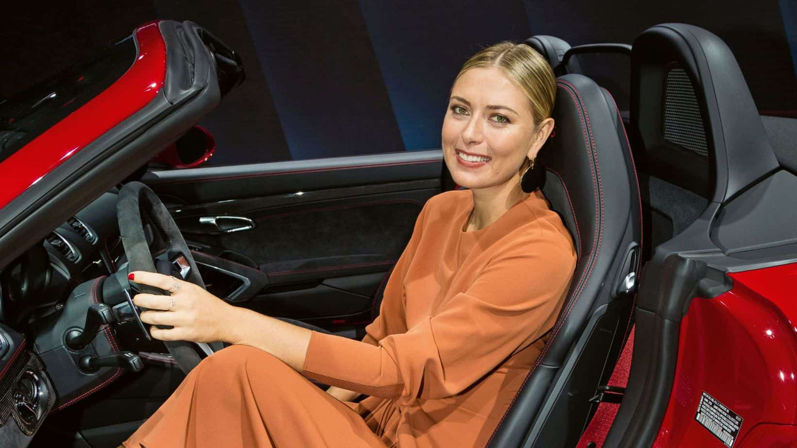 Sharapova driving her Porsche