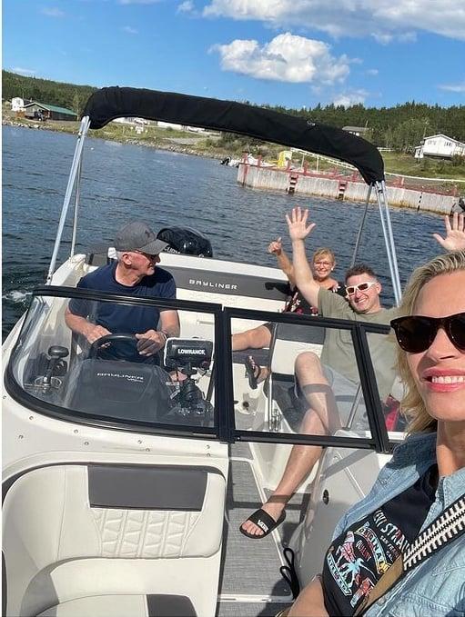 natasha-henstridge-and-her-family-on-a-yacht